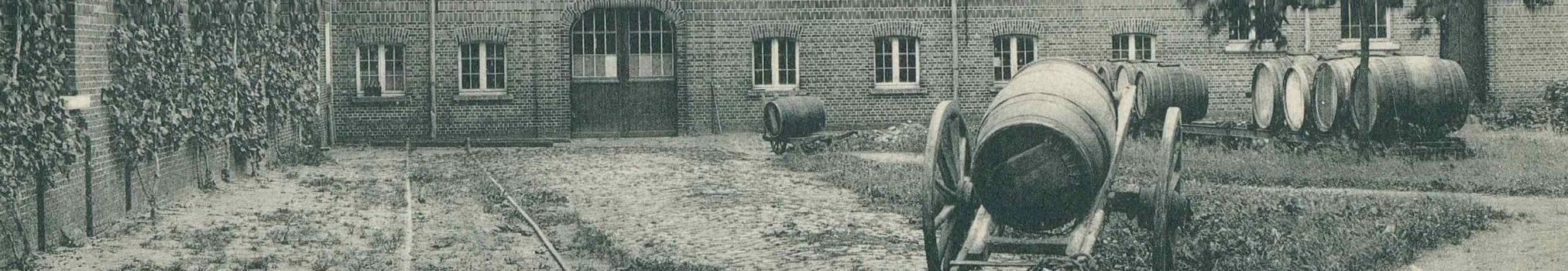 Wooden barrels at Westmalle brewery at the start of the 20th century